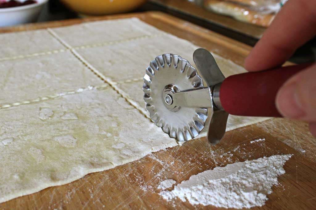 pastry wheel cutting dough