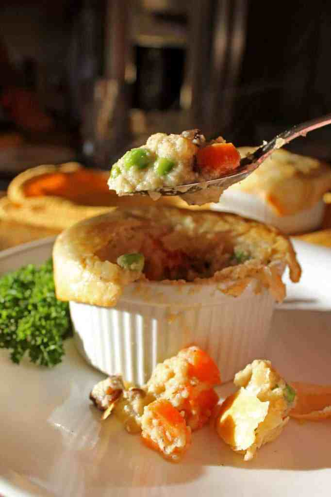 There's just something comforting about warm, flaky pot pie fresh out of the oven and this meatless version is sure to please the biggest of appetites. Mushrooms are the star of the show in these savory healthy mushroom pot pies, with vegetable filling smothered in a cauliflower sauce, with a tender flaky crust. | TheMountainKitchen.com