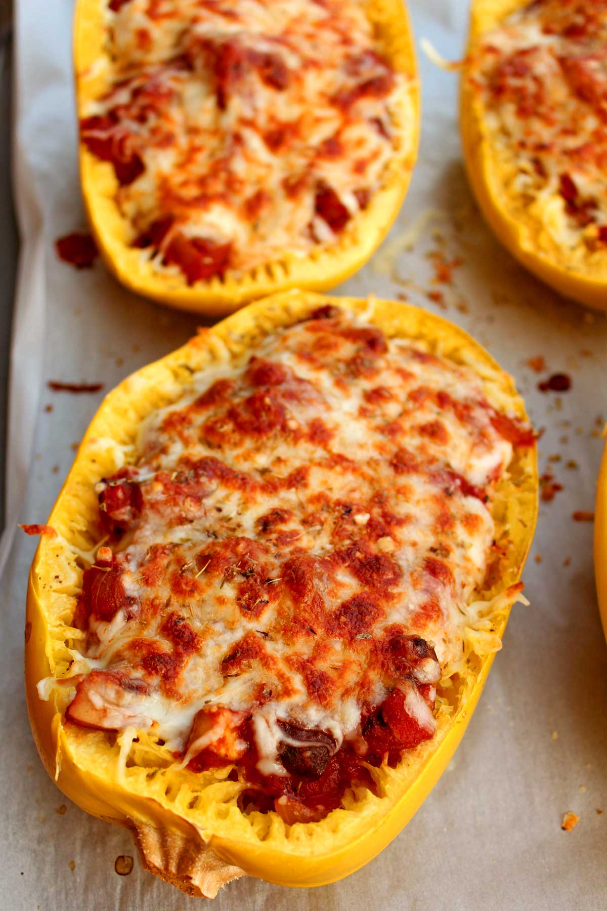 Lasagna-stuffed spaghetti squash are a healthy, low carb, vegetarian and gluten-free way to enjoy Italian food without the calories. Try this tonight! | TheMountainKitchen.com