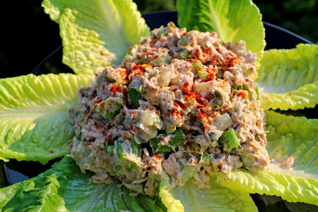 This simple recipe for classic tuna fish salad is made with canned tuna, homemade mayonnaise, and a celery sweet pickle relish. With only a few ingredients you can have a simple tuna salad that's perfect for as is in a sandwich, wrap, or served as an appetizer! | TheMountainKitchen.com