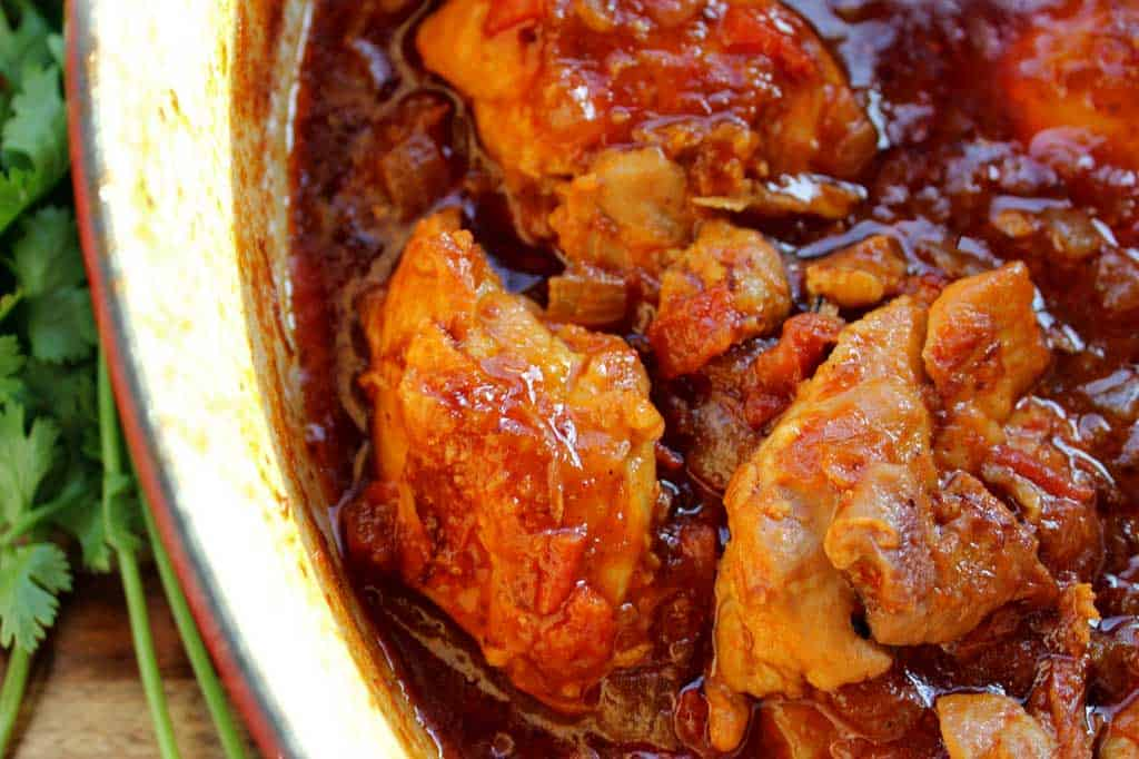 Mexican deviled chicken is an authentic taste of Mexico! Tender, juicy seared chicken smothered in a smoky, spicy tomato based sauce. It's so easy to make!