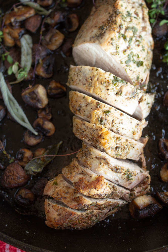 With only a few minutes of prep this delicious healthy roasted pork tenderloin with mushrooms sage and thyme can turn into a gourmet meal in under an hour!
