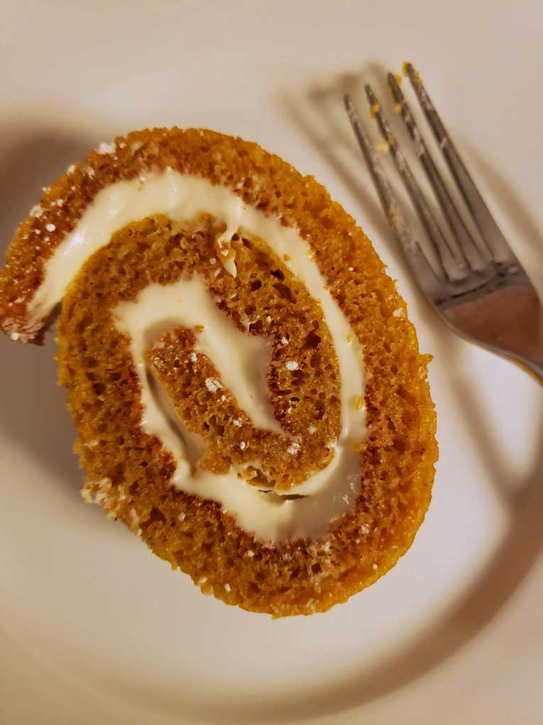slice of easy pumpkin roll on plate with fork
