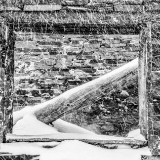 A slate quarry ruin under winter snowfall Snowdonia