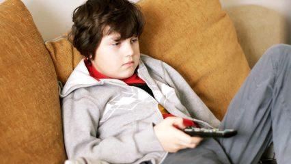kid watches TV