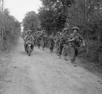 A motorcycle and infantry of the 2nd Glasgow H...