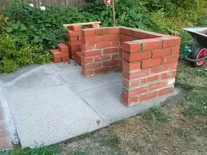 brick barbecue being built seventh course complete