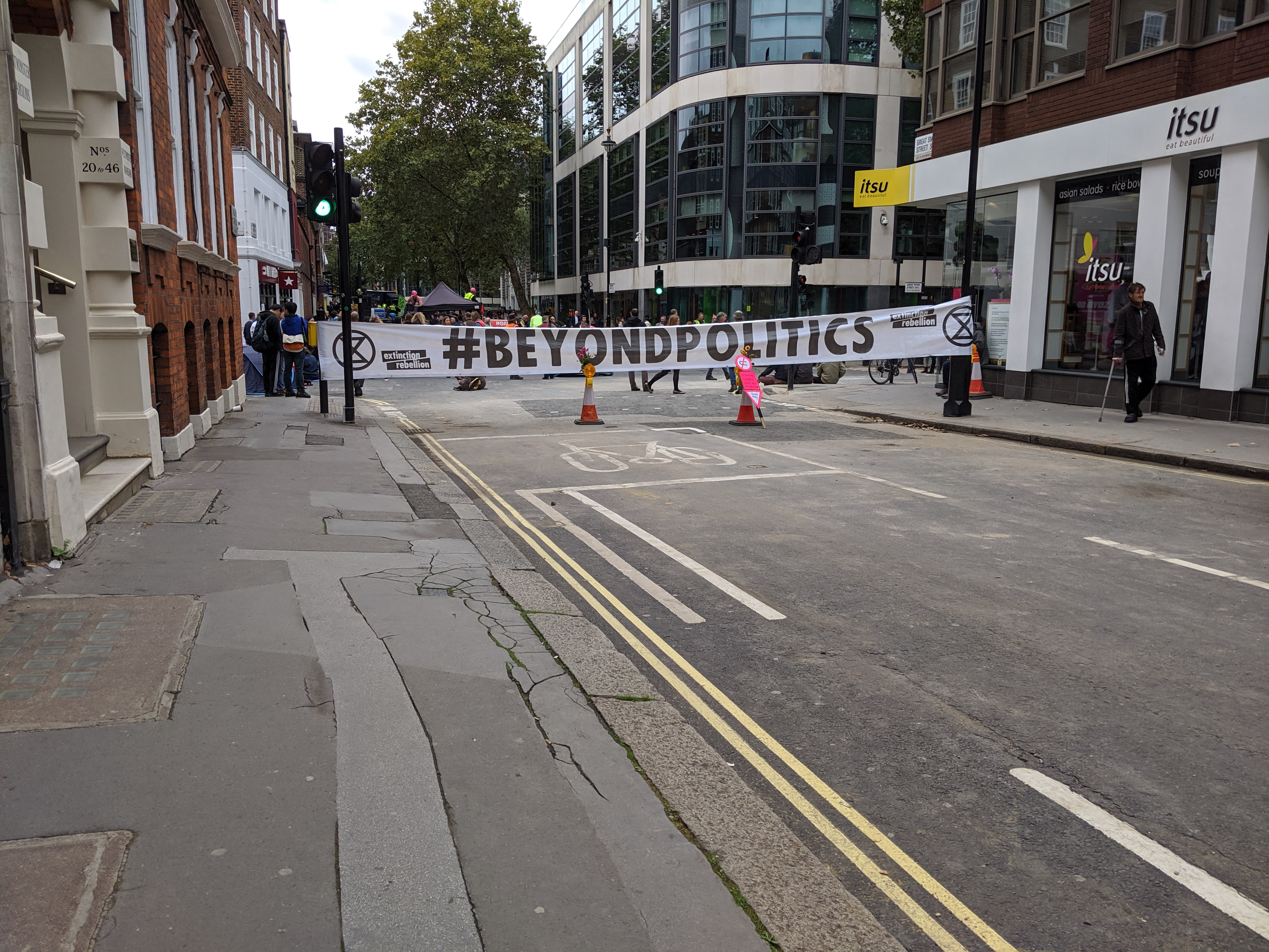 Extinction Rebellion protest on Marsham Street, as seen from Smith Street. The Home Office building is on the left. Taken around 13:30 on Monday 7th October 2019. (Photo: James Kemp)