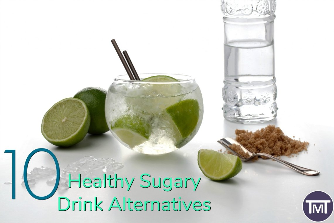 glass of water with glass and limes in with text overlay - 10 healthy sugary drinks alternatives