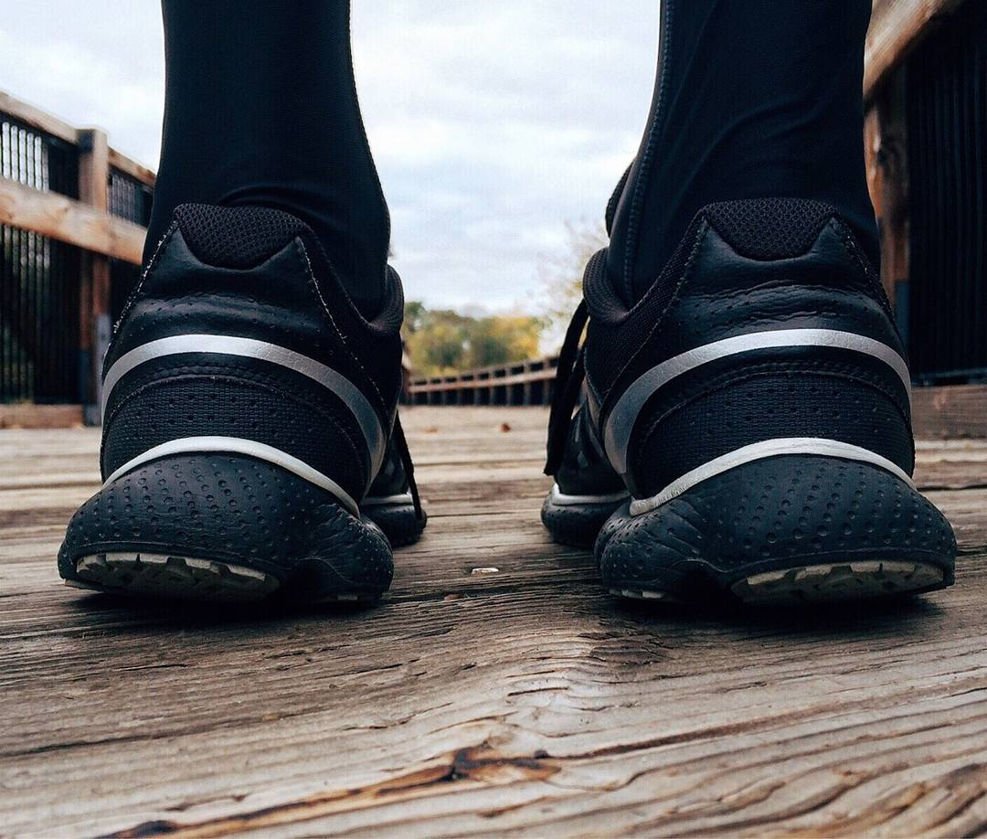 pair of running trainers from the back on wooden boardwalk close-up