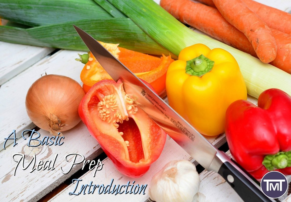 vegetables on a chopping board with knife and text overlay - a basic meal prep introduction