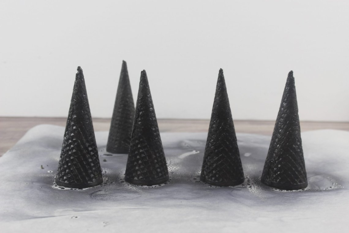 cones on parchment paper sprayed black