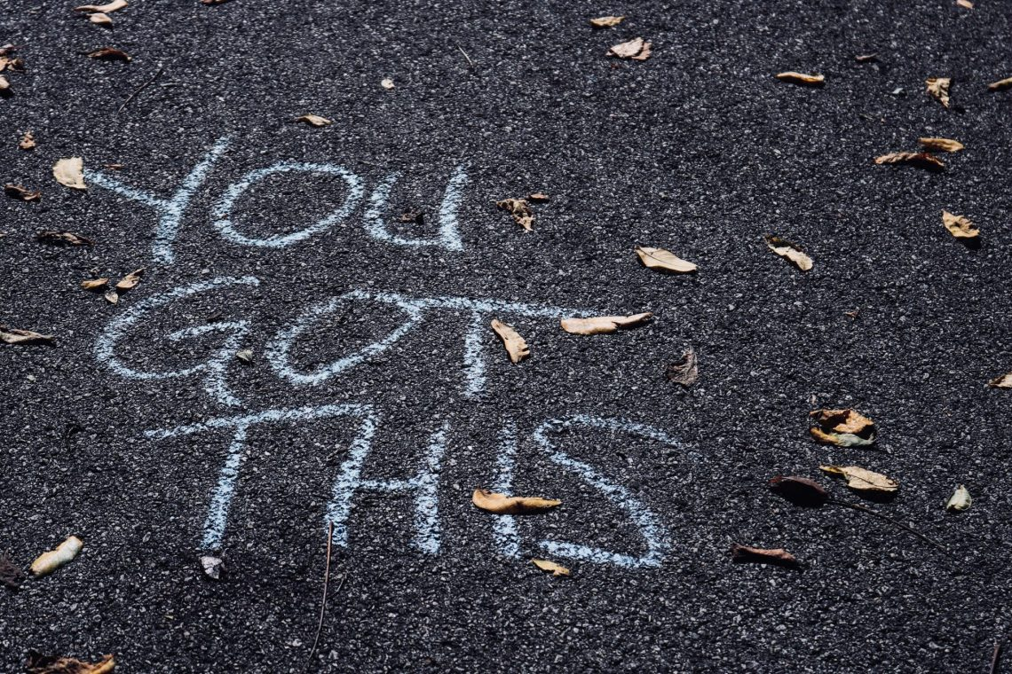 """you got this"" written in chalk on a pavement with leaves"