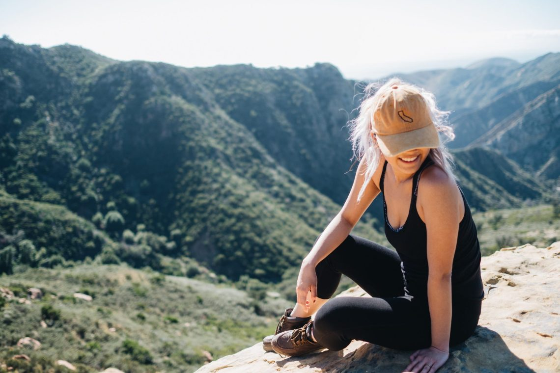 woman sitting on the summit after a hike