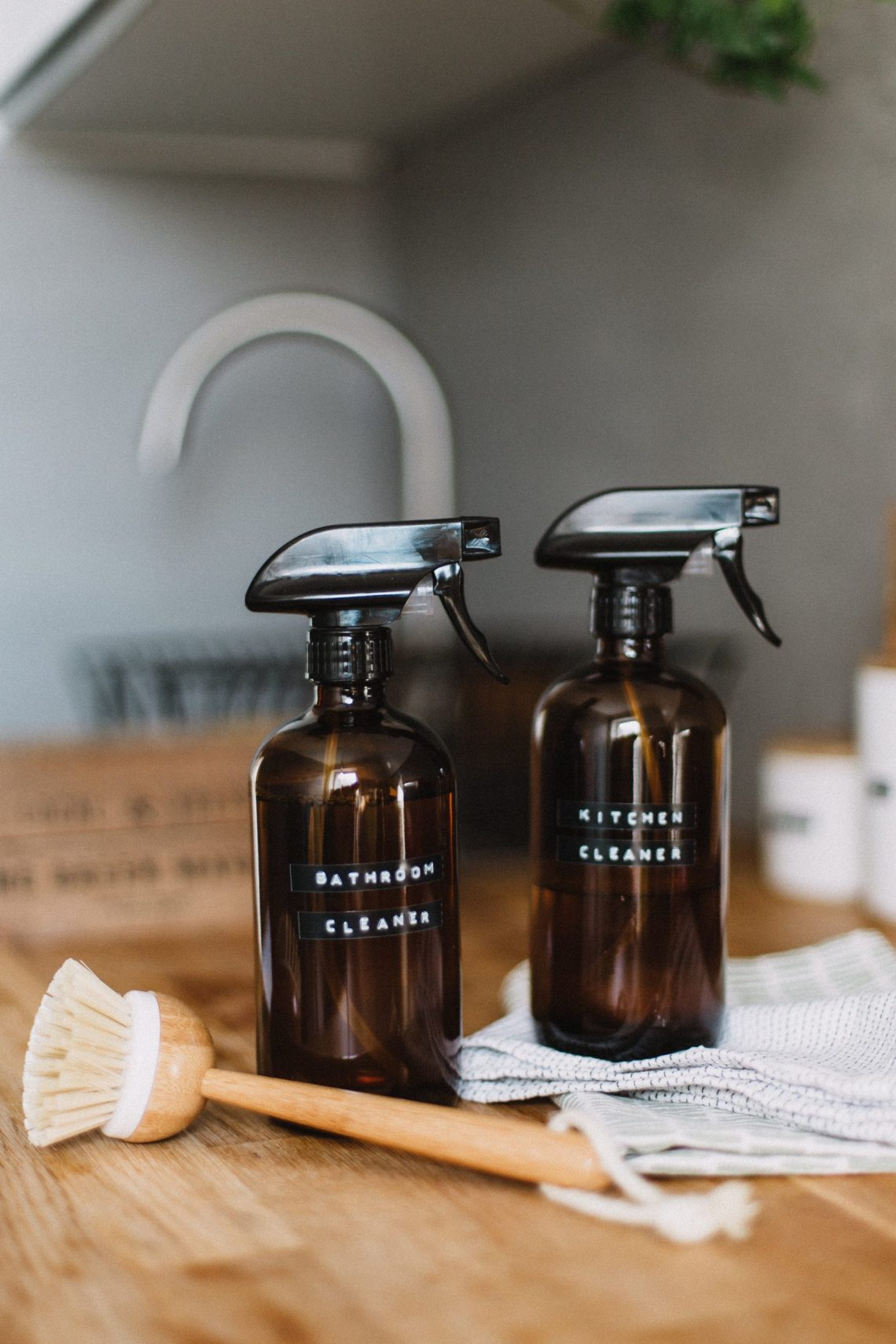 homemade cleaning bottles on counter for a clean home