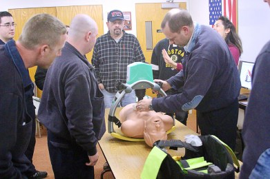 The federal excess property program and donations have also helped WBFD buy needed supplies. Pictured, WBFD firefighters train to use an automatic CPR machine, the purchase of which was made possible by donations from West Barnstable citizens. (Photo provided)