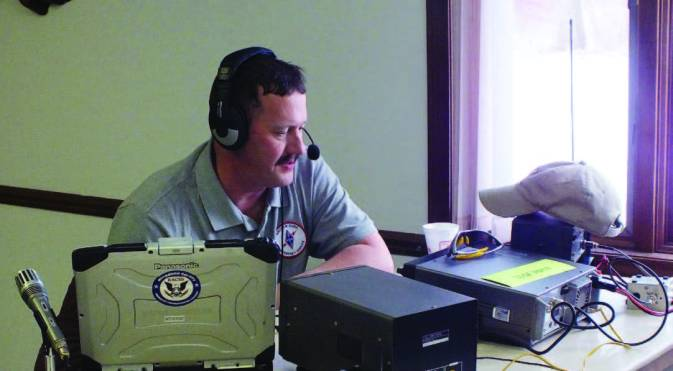 "Thomas ""Randy"" Reed, W8WXM, Muskegon County Skywarn Coordinator, coordinates a Skywarn weather Net in Muskegon. Licensed amateurs who have voluntarily registered their qualifications and equipment with local ARES leadership are available for emergency communications duty in the public service. (Photo credit James Meyers, KC8PCJ)"