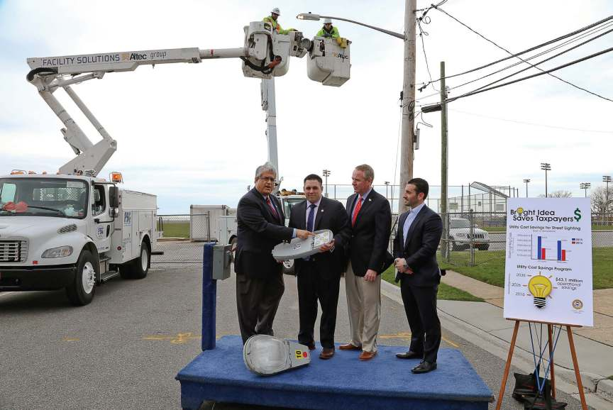 Town of Hempstead Supervisor Anthony Santino, Councilman Anthony D'Esposito and Receiver of Taxes Don Clavin are joined by Ricky Tripodo of Facility Solutions Group at a press conference regarding the town of Hempstead's LED lighting project and its partnership with FSG. The town of Hempstead plans on switching 50,000 of its streetlights to LED lights. The press conference was held on Hamilton Avenue in Island Park where it marked the 30,000th streetlight to be switched over to the new technology. (Photo provided by Facility Solutions Group)