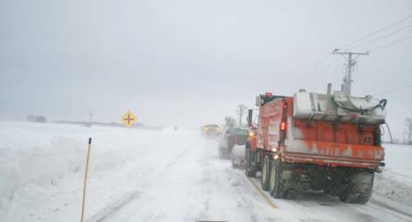 Trucks open a road, following a blizzard in January 2014. During such large events, it is important to evaluate which roads are most critical and to keep the public informed. (Provided by APWA Winter Maintenance Technical Committee)