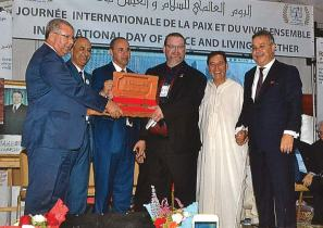 Mayor Josh Pope of Elkader, center, was presented with the key to the city of Mostaganem during a visit to Algeria in September 2016. Elkader has been sister cities with another Algerian city, Mascara, since 1984. (Photo provided)