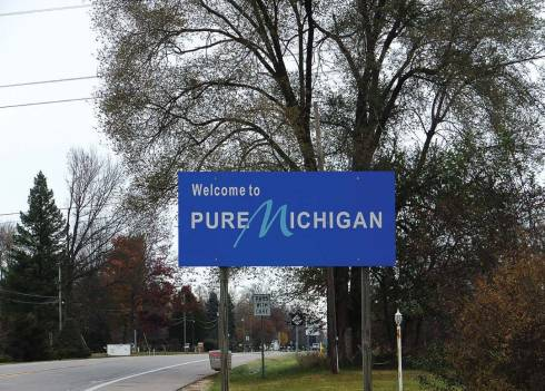 """The sign welcoming visitors to the state of Michigan doesn't give any indication of the woes some townships and counties have experienced due to the so-called """"dark store strategy."""" (Photo provided)"""
