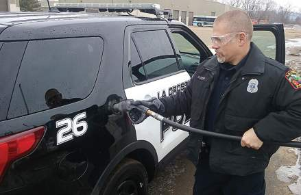 A La Crosse, Wis., police officer fuels his bi-fuel squad car with propane. The department has enjoyed many benefits since retrofitting its fleet to bi-fuel propane. (Photo provided)