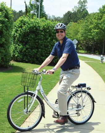 Councilman Jason Binder tests out the Alpharetta, Ga., bike share program. Binder also acts as the council liaison to the recreation commission. (Photo provided)