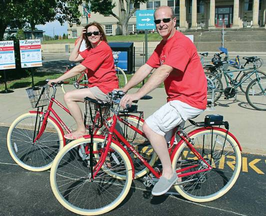 Jim and Melissa Patterson from Stark County, Ohio, test out the city's bike share program, which is currently in its second year. This city's program is unique because it allows residents to use their library cards to rent a bicycle instead of a credit card. (Photo provided)