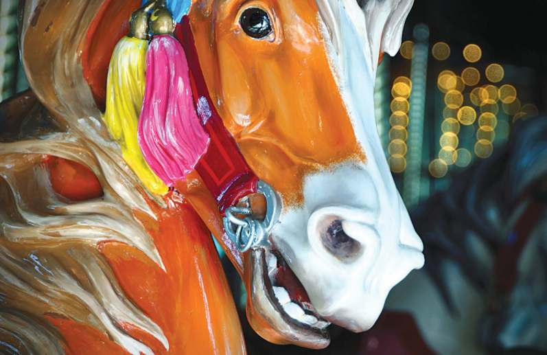 Each of the carousels feature wooden horses and other animals, expertly carved and then painted. (Photo provided by Carriage House)