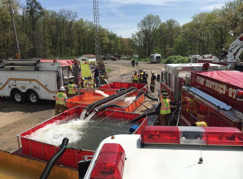 Multiple departments work together on a large scale water supply training class. Training with mutual aid fire departments can help pinpoint weaknesses or deficiencies in equipment or personnel. (Photo provided by Henry Lovett of TurboDraft )