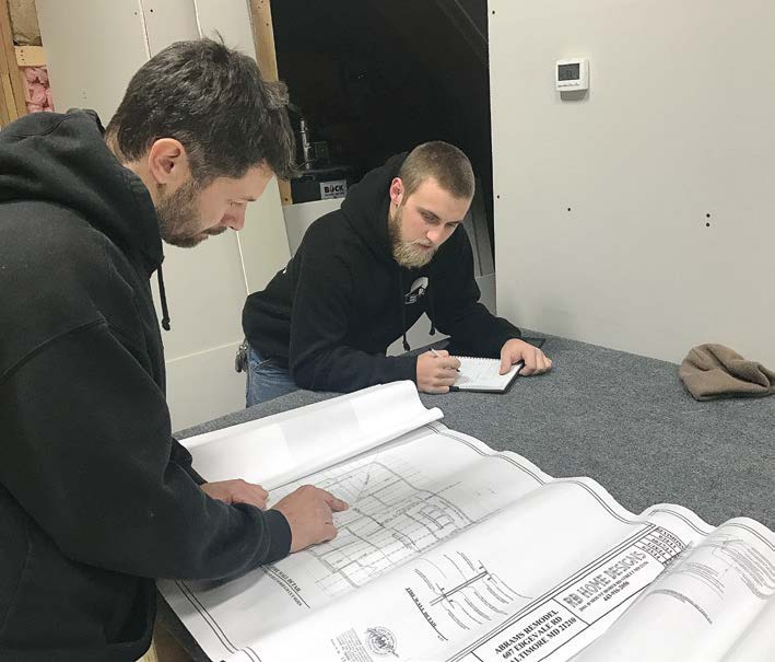 Zach Burnham, right, graduated from Harford Technical High School — located in Bel Air, Maryland — in 2014 with all four COAs and has since been working for a contractor. Zach coordinates the schedule and performs work, quality control and customer care. Zach credits his professional success in large part to his experience at school and his ICC certificates. (Photo provided)