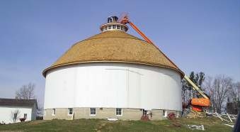 Further renovations were completed on this white round barn when a severe storm in August 2015 caused damage. These renovations include a new roof that was placed in 2016. (Finished roof: Provided; under construction: David Hazledine)