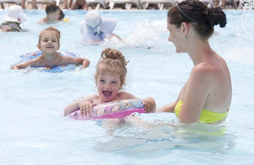 Municipal pools provide fun, a chance to learn swimming in a largely controlled environment and a way to cool off on a summer's day; however, they can be costly to maintain, leaving municipalities to decide whether or not to keep them open. (Shutterstock.com)