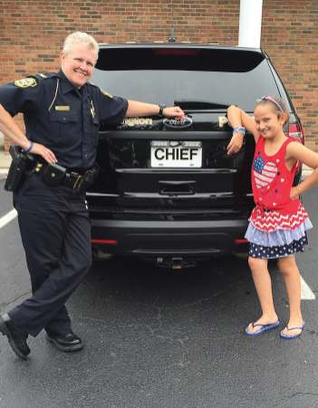 Chief Tracy Hahn poses with a potential future chief. (Photo provided)