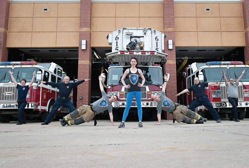 Yoga for First Responders founder Olivia Kvitne has worked with police and fire departments across the country. The Iowa departments represented are Indianola Fire Department, Carlisle Fire Department and Norwalk Fire Department. Pictured from left are Jared Johnson, Roger Barry, Brian Eppers, Kvitne, Brian Onstot, Jeremy Cross and Chief Ryan Coburn. (Photo provided)