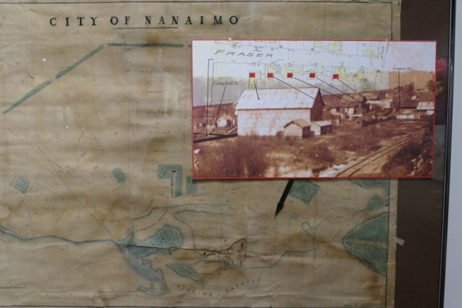 The only known photo of Nanaimo's Red Light District atop an early map of the city. Via Nanaimo Museum