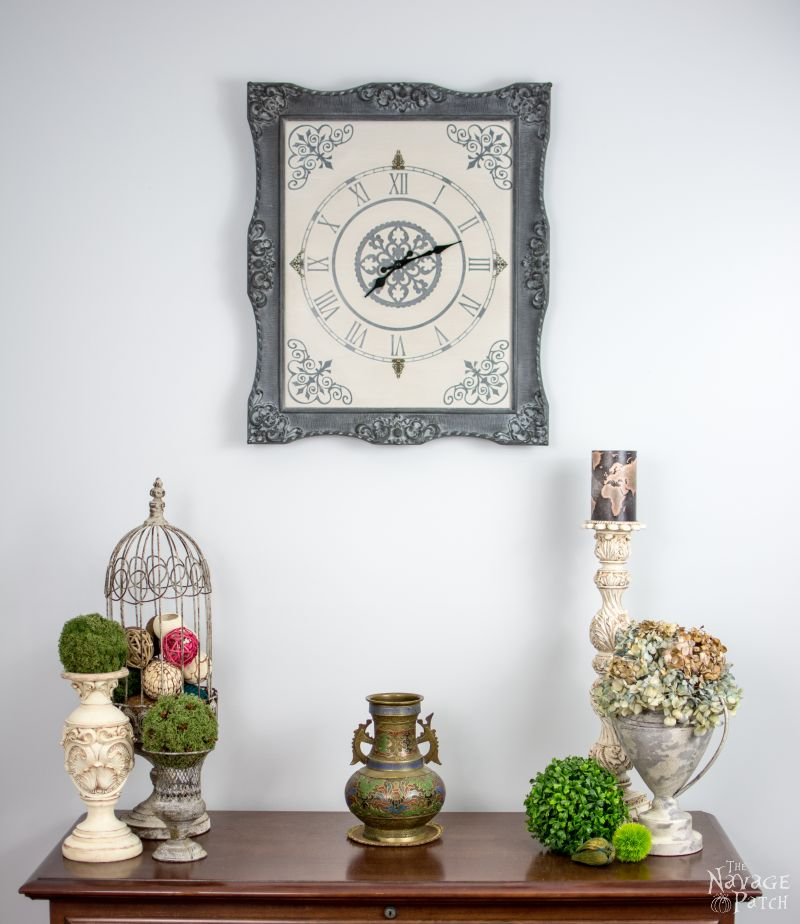 Ornate Frame to Wall Clock | Upcycled picture frame | How to make a wall clock from picture frame | DIY painted and stenciled wall clock | Homemade chalk paint recipe | DIY farmhouse style home decor | How to use white wax | Ornate picture frame makeover | How to build a stylish clock | How to stencil | TheNavagePatch.com