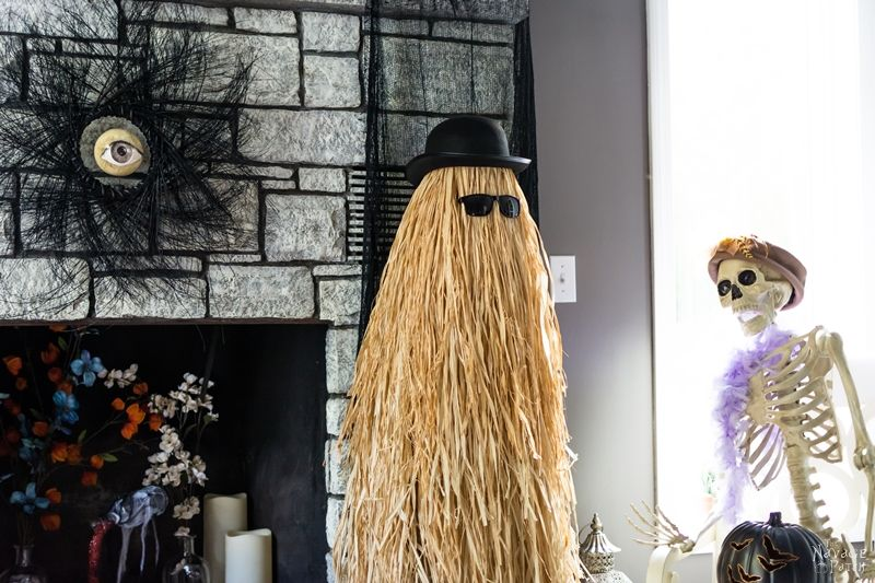 Cousin Itt {Halloween prop} | Easy and budget friendly DIY Halloween prop| DIY Addams Family prop| Step-by-step tutorial for DIY Cousin Itt | DIY Dollar store Halloween decorations| Upcycled tomato cage to Halloween decoration | Before & After | TheNavagePatch.com
