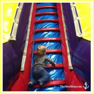 Climbing the inflatable slide at Pump It Up Jacksonville