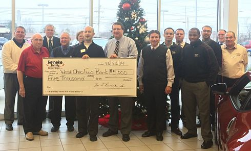 Members of the Reineke family and staff present the check for $5k