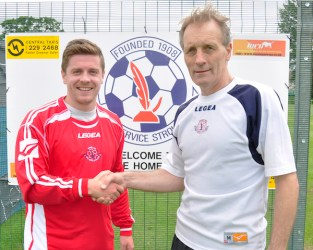 Civil Service manager Alex Cunnignham welcomes Scott Clapperton to Marine Drive. Claperton has played for Civil Service before moving to Spartans.