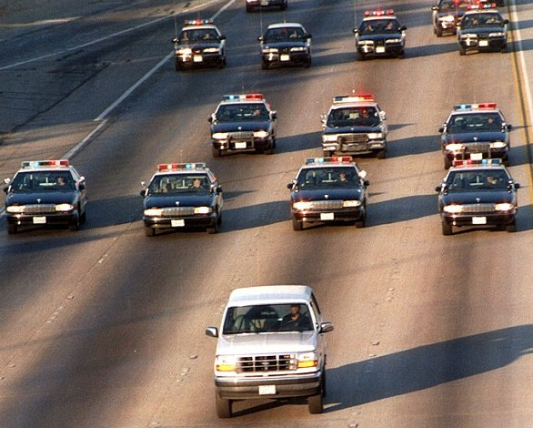 Al Cowlings and O.J. Simpson flee police in 1994