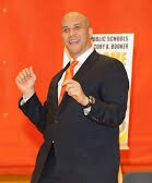 BOOKER DANCES AFTER ED BUCK AGREES TO HUGE DONATION.