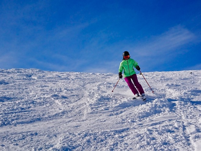 Girl skiing in Lappland in white snow and with blue ski