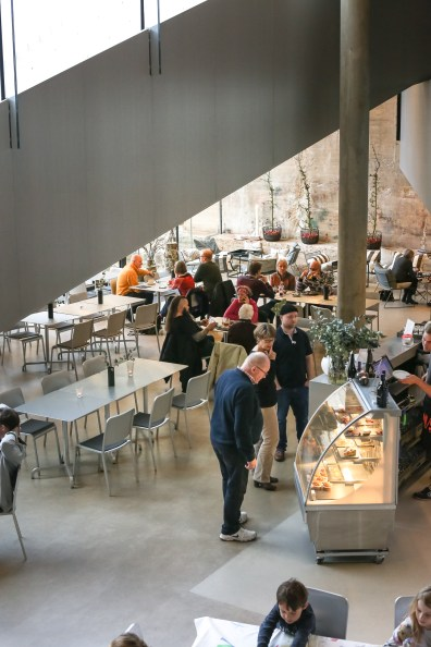 The interior of the well designed cafe inside the Maritime Museum in Helsingor, Denmark. It's built into the walls of a dry-dock with cozy places to sit and enjoy a coffee and cake.