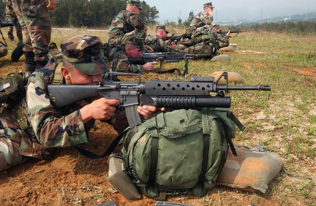 US Marine Corps (USMC) members from L Company, 3rd Battalion, 3rd Marine Regiment, 3rd Marine Division, perform a biathlon on the Camp Hansen ranges, firing a Colt 5.56mm M16A2 Assault Rifle.
