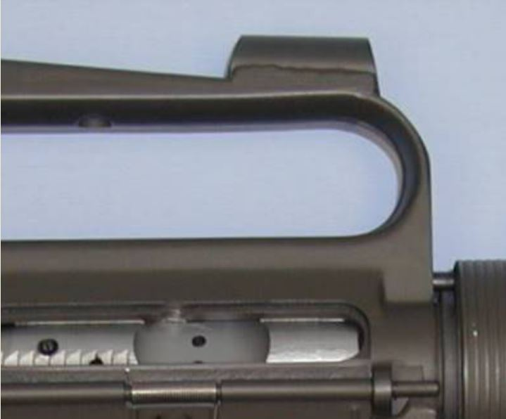 One version of the M16k used a ghost ring front sight consisting of a metal tube welded onto the carry handle