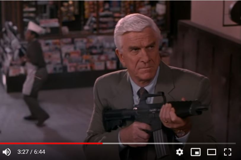 The M16k portrayed in the opening shootout of the Naked Gun 33 1/3 movie.  Yes, that's OJ Simpson juggling babies n the background