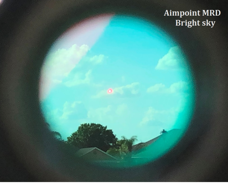 Aimpoint on full brightness.  Can you see the dot?  It kinda washes out, it's just a pin prick of light