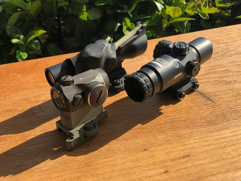 The Three Amigos:  A TA-45-2 ACOG (with a keychaing light under a section of innertube to help brighten it up), An Aimpoint mini-red dot, and the PA GLx 2x Prism